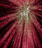 Starburst rouge et vert sur le fond noir Image libre de droits