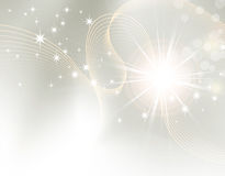 Starburst - sparkle background. Light festive background with stars Royalty Free Stock Image