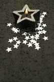 Starcandle with copy space. Black starcandle with small stars and glitter background Studio Shot Stock Photo