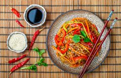 Starch rice, potato noodles with vegetables - bell peppers, carrots, cucumber, sesame seeds, cilantro and soy sauce. Vegetarian dish. A delicious lunch or stock photography