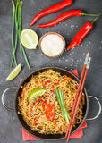 Starch rice, potatoes noodles with beef and vegetables. Bell peppers, carrots, zucchini, sesame seeds, lime, chili, cilantro and soy sauce. A delicious dinner royalty free stock photo