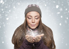 Stardust. Beautiful blond girl is blowing stradust to the air Stock Photography