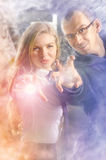 Stardust throwers. Young couple learns to throw stardust Royalty Free Stock Image