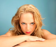 Stare of a Beautiful Woman. Gripping Stare of a Beautiful Woman on Blue Background Stock Image