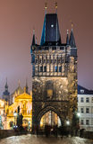Stare Mesto Tower from the Charles Bridge at night, Prague. Magnificent Gothic structure called Stare Mesto Tower, was built in 14th century, fitting ornament Stock Photography