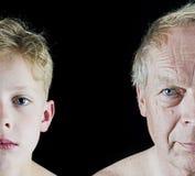 Starego człowieka i chłopiec porównanie zdjęcia royalty free