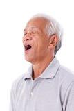 Starego człowieka ziewanie Zdjęcia Stock