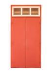 Starego stylu drewniany drzwi w czerwonym kolorze odizolowywającym na bielu Zdjęcie Royalty Free