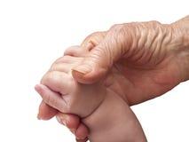 Starej kobiety i dziecka ręka Zdjęcia Royalty Free