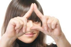 Starende blik door driehoeksframe Stock Foto's