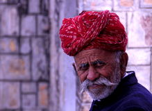 Stares. A local man stares at tourists in rajasthan Royalty Free Stock Image