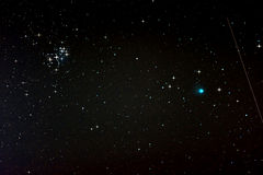 Starfield with Comet Lovejoy, Falling Star and Pleiades Stock Photo