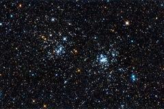 Starfield. En dubbel stjärna samla i en klunga i Perseus Arkivbild
