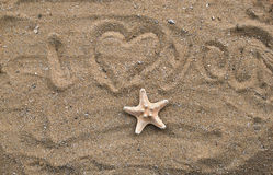 Starfish. On beach sand with inscription I love you Royalty Free Stock Images