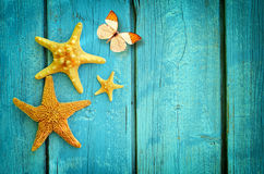 Free Starfish And Butterfly On The Blue Wooden Background. Summer Concept. Stock Photo - 73211700