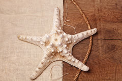Starfish on a background of a wooden table and sacking. Starfish on a wooden table, souvenir Royalty Free Stock Images