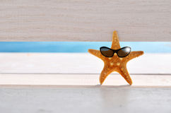 Starfish. On the beach with glasses royalty free stock image
