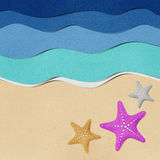 Starfish on beach recycled paper. Royalty Free Stock Photo