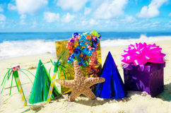 Starfish with  Birthday decorations on the beach Royalty Free Stock Images