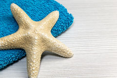 Starfish with blue towel Stock Photography