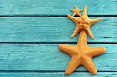 Starfish on blue wooden background. Top view . Stock Photography