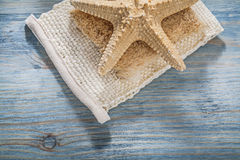 Starfish body scrubber on wooden board healthcare concept Stock Image