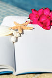 Starfish on a book Royalty Free Stock Photos