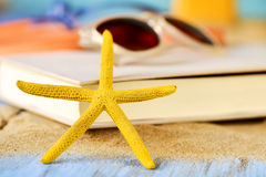 Starfish, book and sunglasses Royalty Free Stock Images
