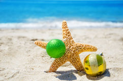 Starfish with Christmas ball - holiday concept Stock Photos