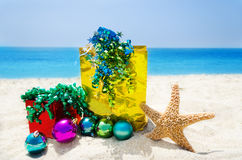 Starfish with Christmas balls and gifts - holiday concept Royalty Free Stock Image