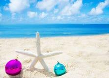 Starfish with Christmas balls - holiday concept Royalty Free Stock Photos