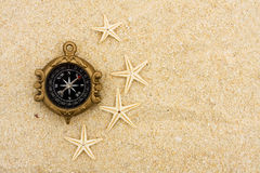 Starfish and Compass Royalty Free Stock Image
