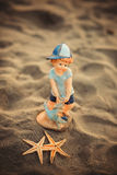 Starfish with the figure of a boy on the sand. In Paradise Stock Photography