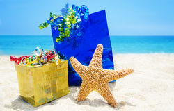 Starfish with gifts on the beach - holiday concept Royalty Free Stock Photography