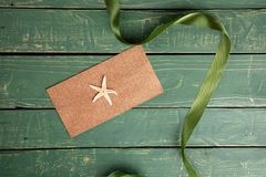 Starfish with a green ribbon stock image