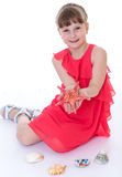 Starfish in the hands of a little girl. Stock Image