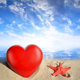 Starfish with heart on beach Royalty Free Stock Images