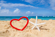 Starfish with heart shape on the sandy beach Royalty Free Stock Image