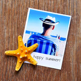 Starfish, and an instant photo with the text happy summer Royalty Free Stock Photography