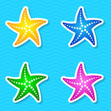 Starfish labels. Colorful starfish labels  on blue background Stock Photography