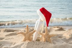 Starfish with message in a bottle and Santa cap stock images