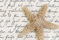 Starfish on old letter Stock Images