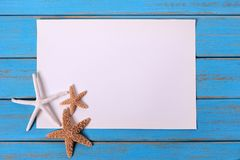 Starfish old weathered blue summer beach wood deck background stock photos