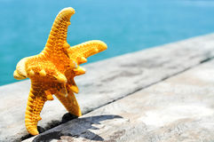 Starfish on an old wooden pier on the sea Royalty Free Stock Images