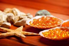 Starfish and orange bath salt Royalty Free Stock Photography