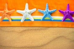 Starfish on orange beach towel Royalty Free Stock Images