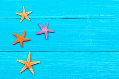 Starfish on painted rustic wooden boards Stock Images