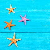 Starfish on painted rustic wooden boards Royalty Free Stock Photography