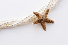 Starfish and pearl Royalty Free Stock Image