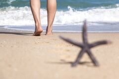 A Starfish and A Person on Beach Sand for Summer Holidays Concept